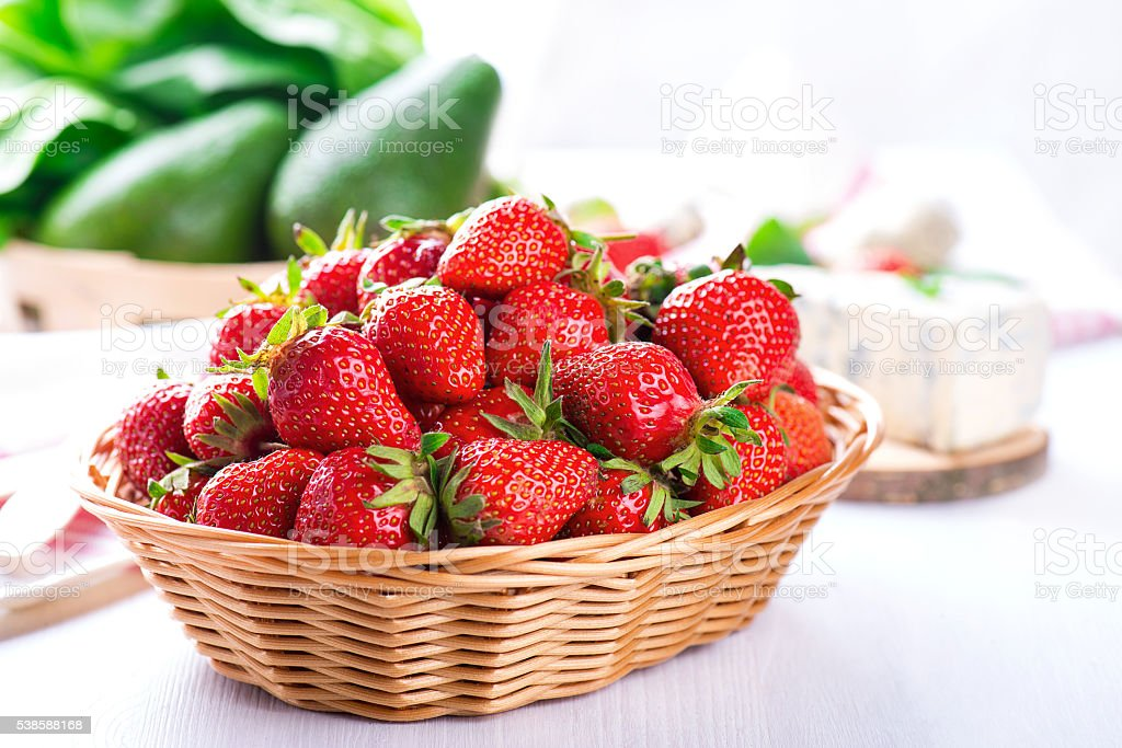 fresh strawberry in the basket on white table stock photo
