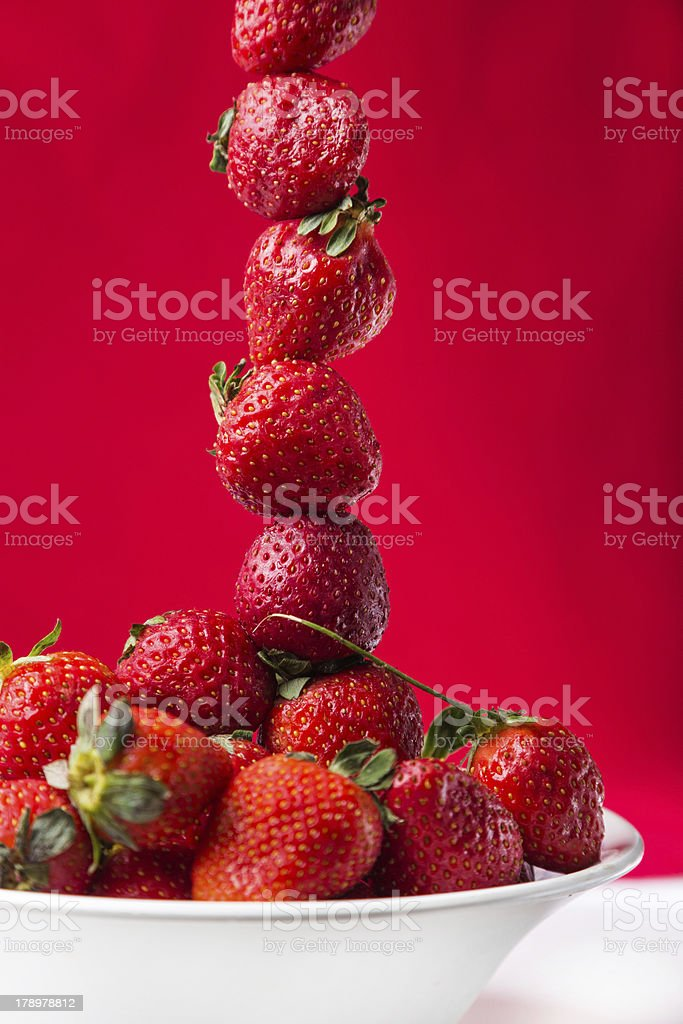 fresh strawberry in white plate on red background royalty-free stock photo