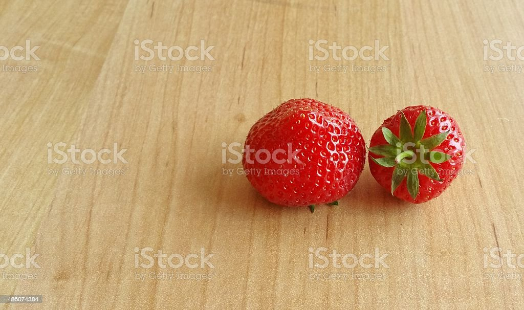 Fresh strawberry on wooden background stock photo