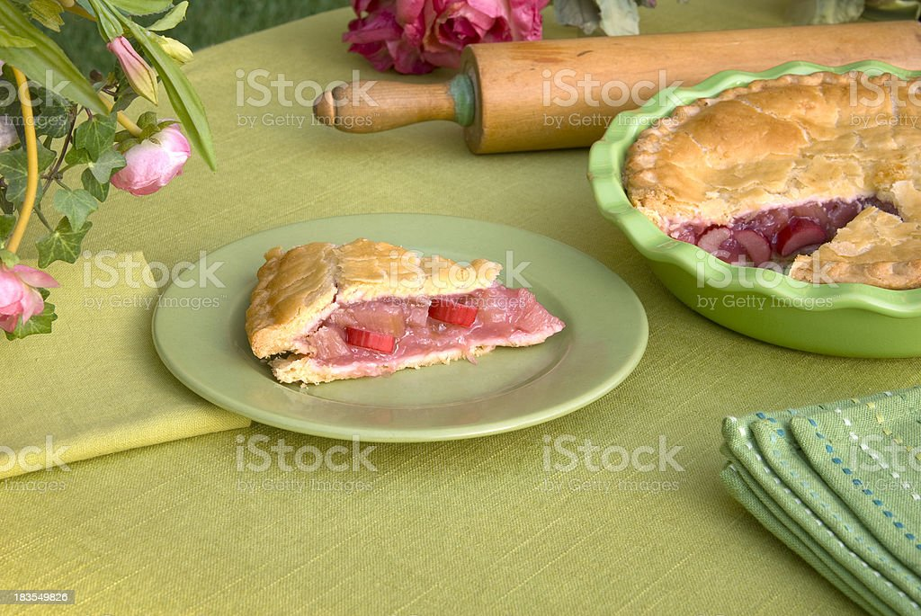 Fresh Strawberry Rhubarb Fruit Pie & Summer Picnic Dessert & Dining Table stock photo
