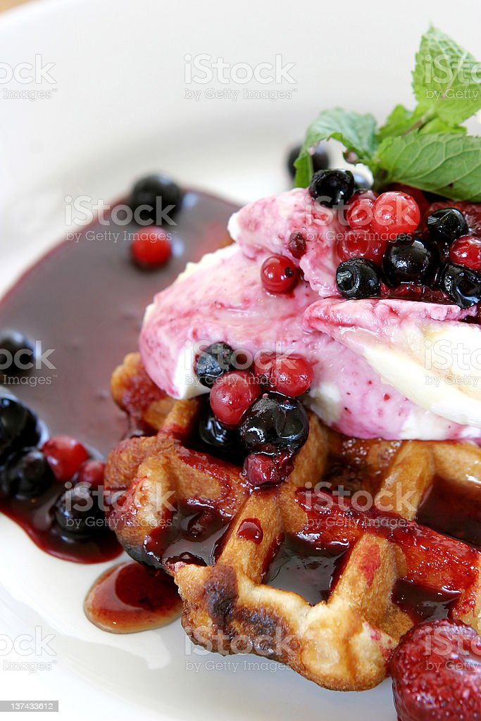 Fresh summer berries and ice cream on waffles royalty-free stock photo