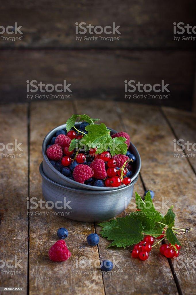 fresh summer berries in  metal bowl.tif stock photo