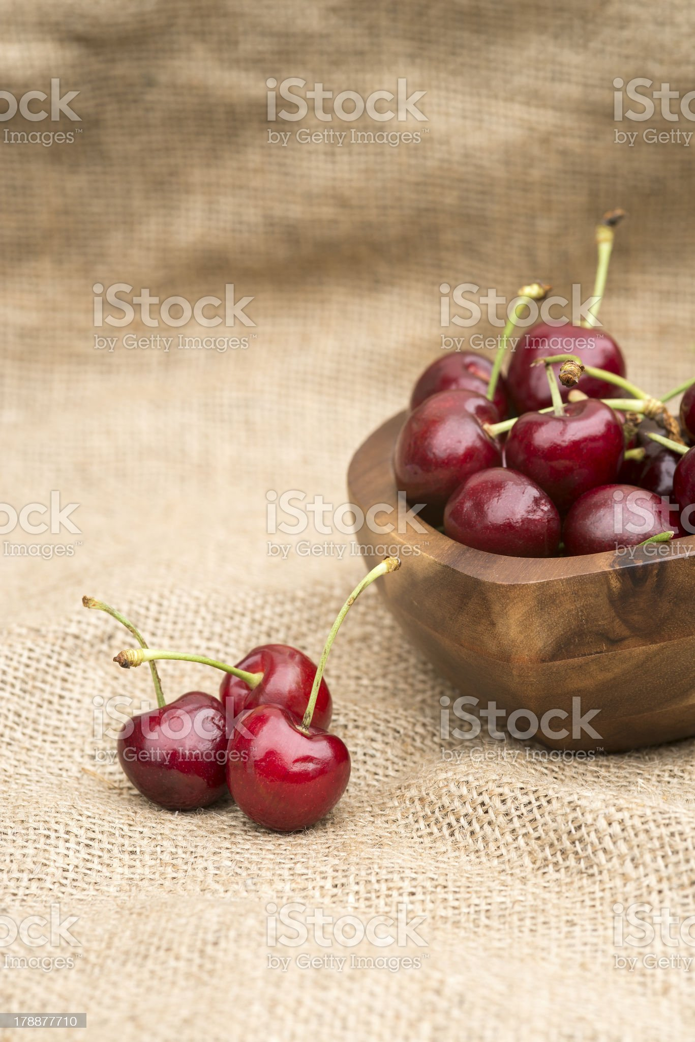 Fresh Summer cherries in wooden bowl royalty-free stock photo