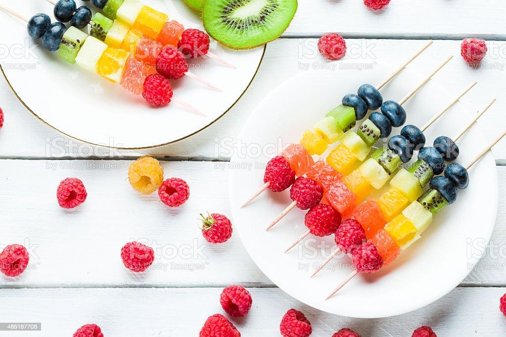 Fresh summer fruits on sticks stock photo