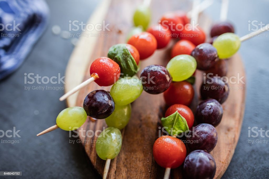 Fresh summer fruits on sticks. With mint leaves. stock photo