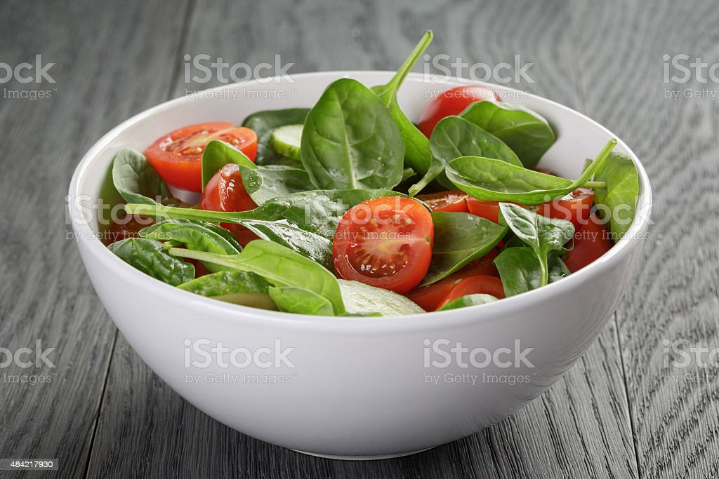 fresh summer organic salad with tomatoes cucumbers and spinach stock photo