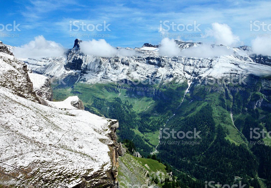 Fresh summer snow in the Swiss Alps stock photo