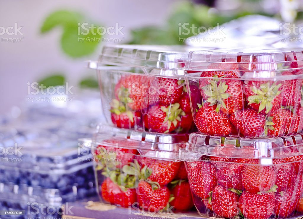 Fresh Summer Strawberries and blueberries for sale royalty-free stock photo
