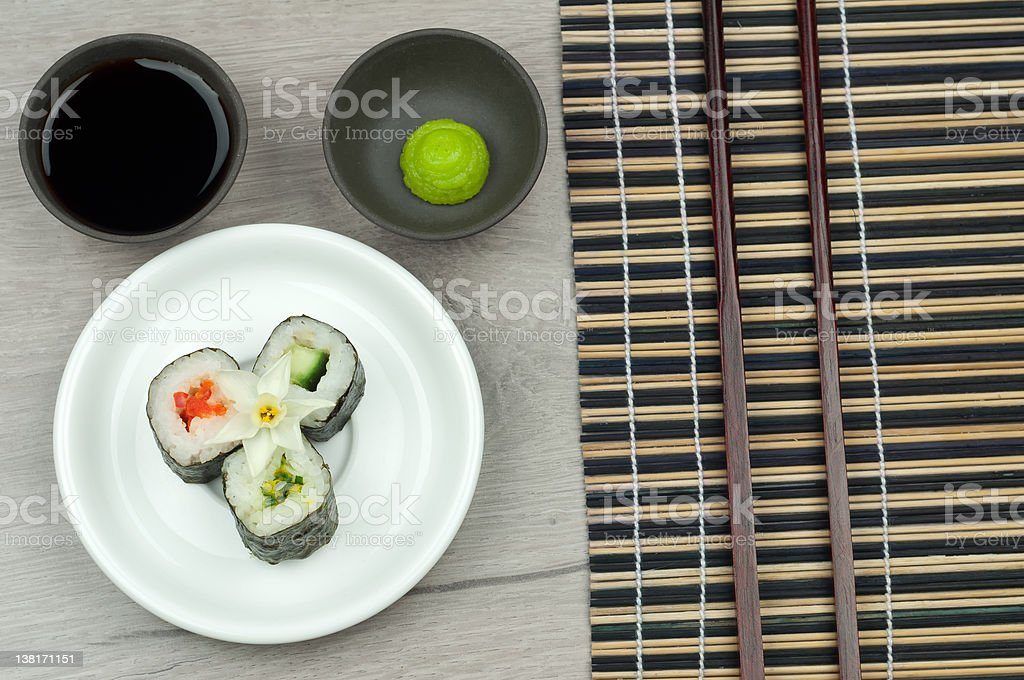 fresh sushi roll with wasabi and soya sauce top view. royalty-free stock photo