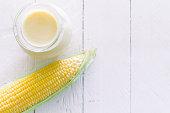 Fresh sweet corn milk on wooden background