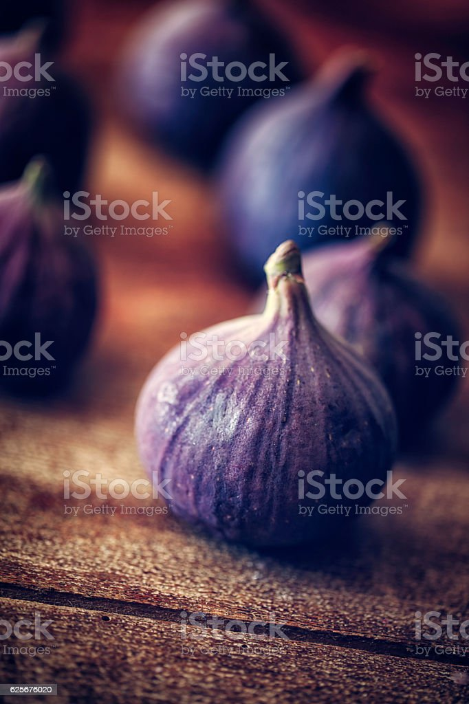 Fresh Sweet Figs on Wooden Background stock photo