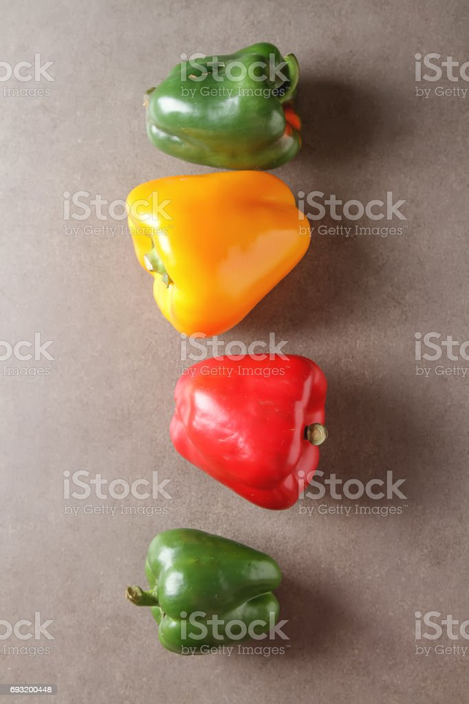 Fresh sweet vegetables Red, Yellow, Green Peppers. Dark background. stock photo