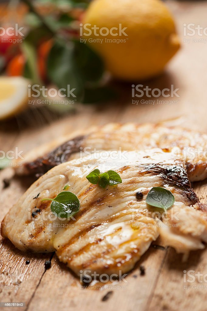 Fresh swordfish steaks on a cutting board with seasonings stock photo
