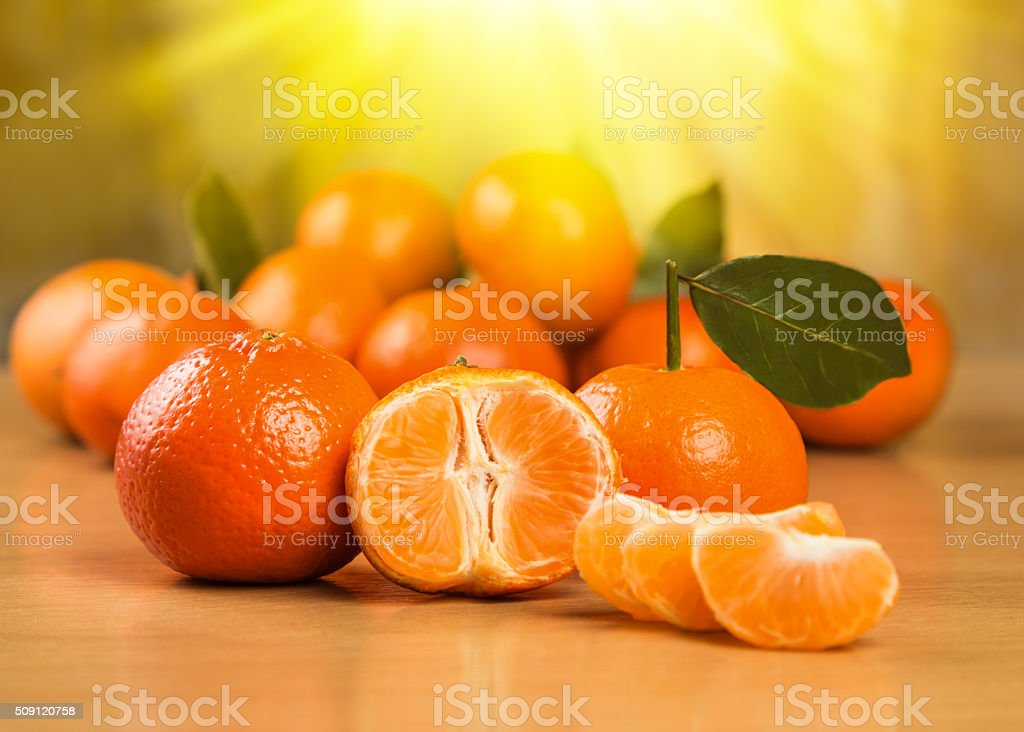 Fresh tangerine on a wooden surface stock photo