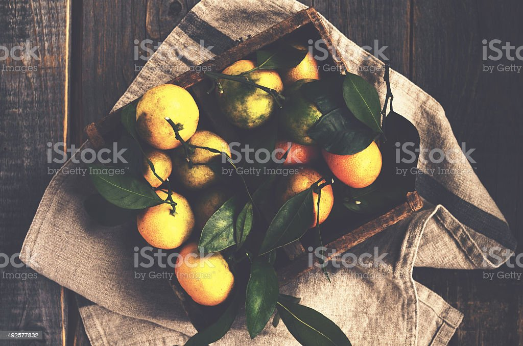 Fresh tangerines in rustic wooden box, top view stock photo