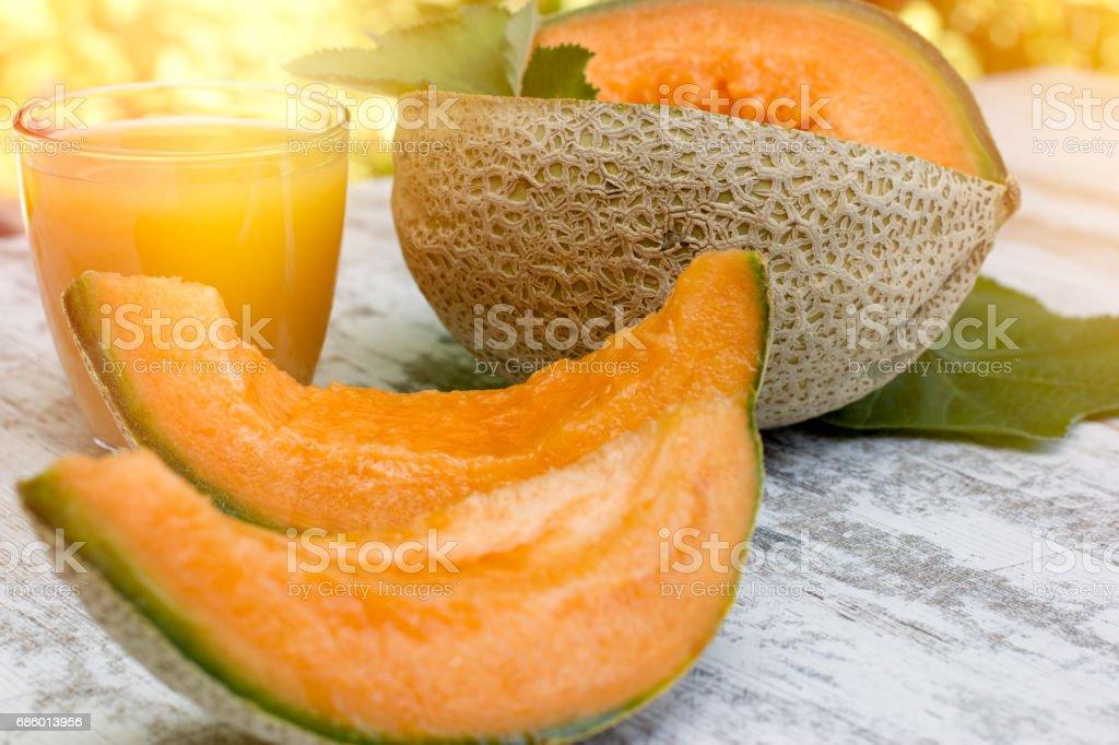 Fresh, tasty and juicy melon - cantaloupe and melon juice stock photo