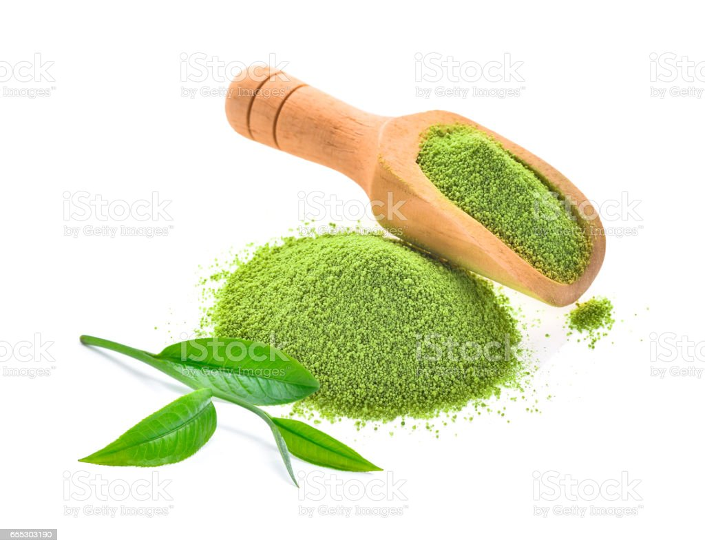 fresh tea leaf and green tea powder in wooden scoop isolated on white background stock photo
