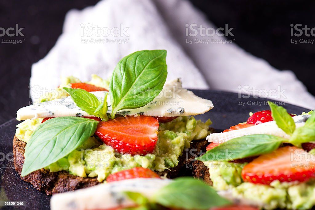 Fresh toast with strawberry on black plate stock photo