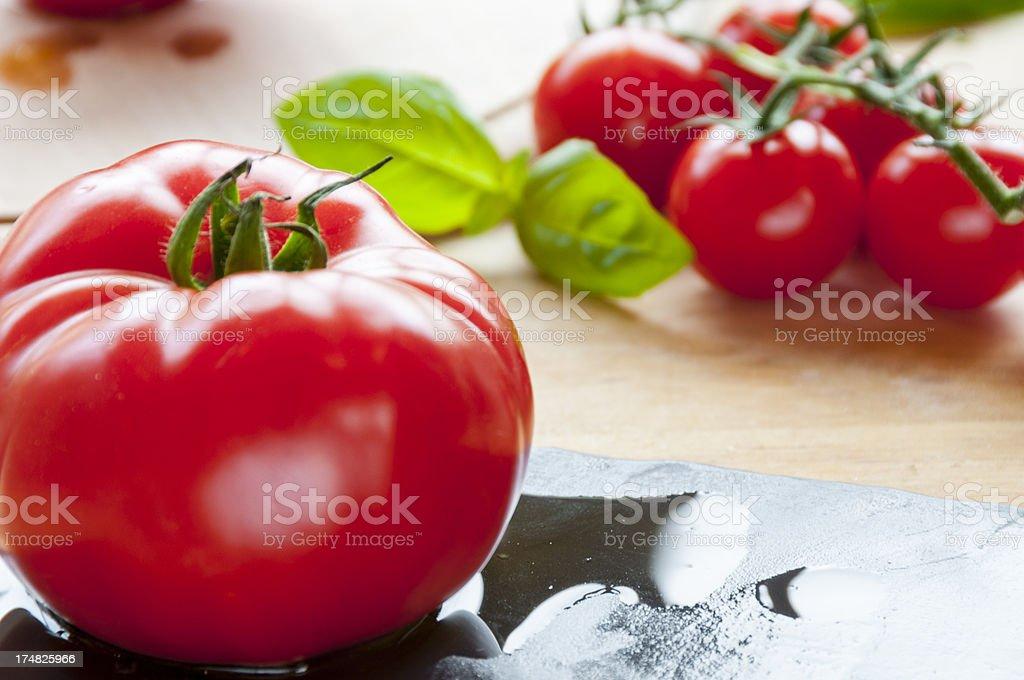 Fresh Tomato And Basil On A Slate royalty-free stock photo