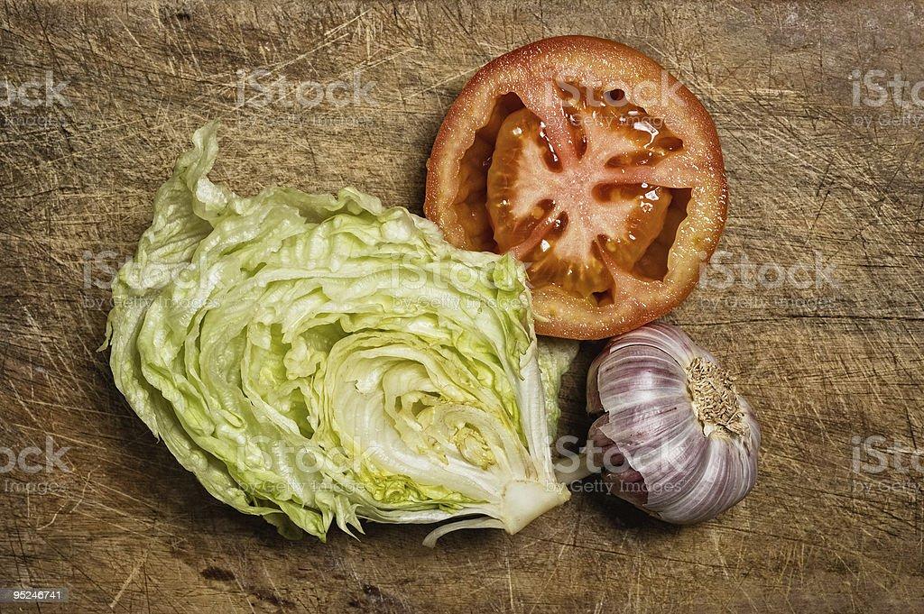 Fresh tomato, lettuce and garlic. stock photo