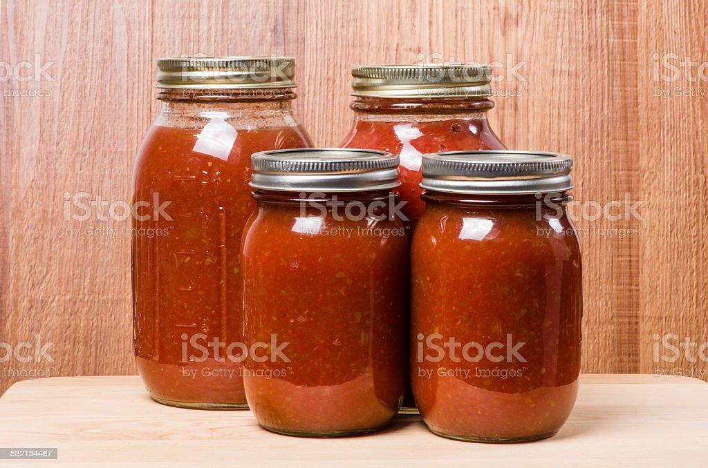 Fresh tomato sauce in jars stock photo
