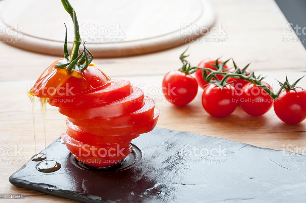 Fresh Tomato Sliced On A Slate royalty-free stock photo