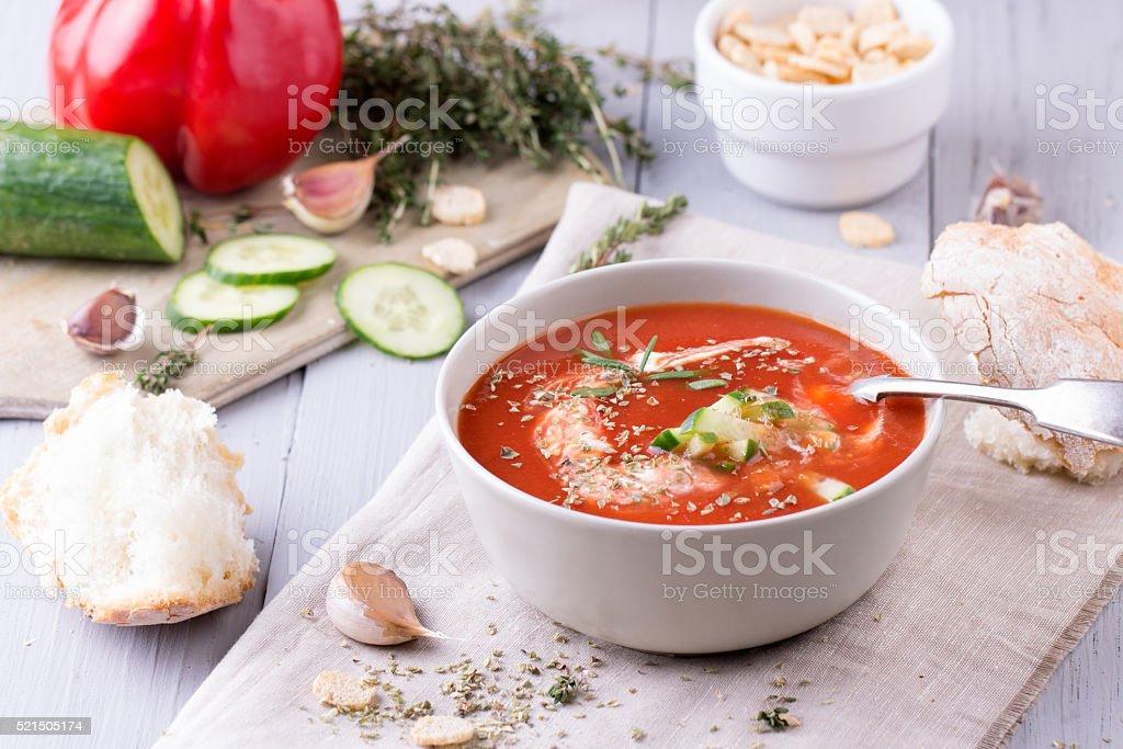 fresh tomato soup in a grey bowl stock photo