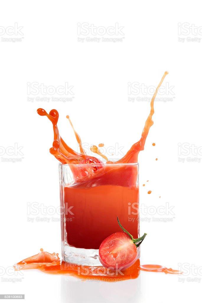 Fresh tomatoe juice in glass stock photo