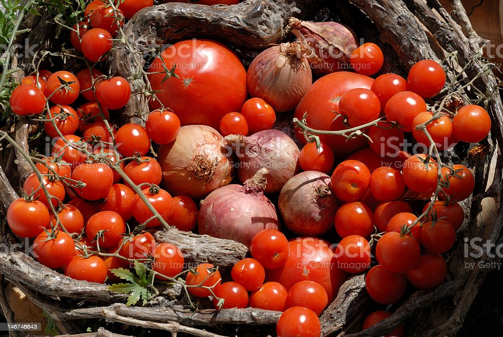Fresh tomatoes and onions royalty-free stock photo