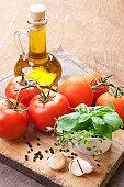 Fresh tomatoes, basil, thyme and olive.