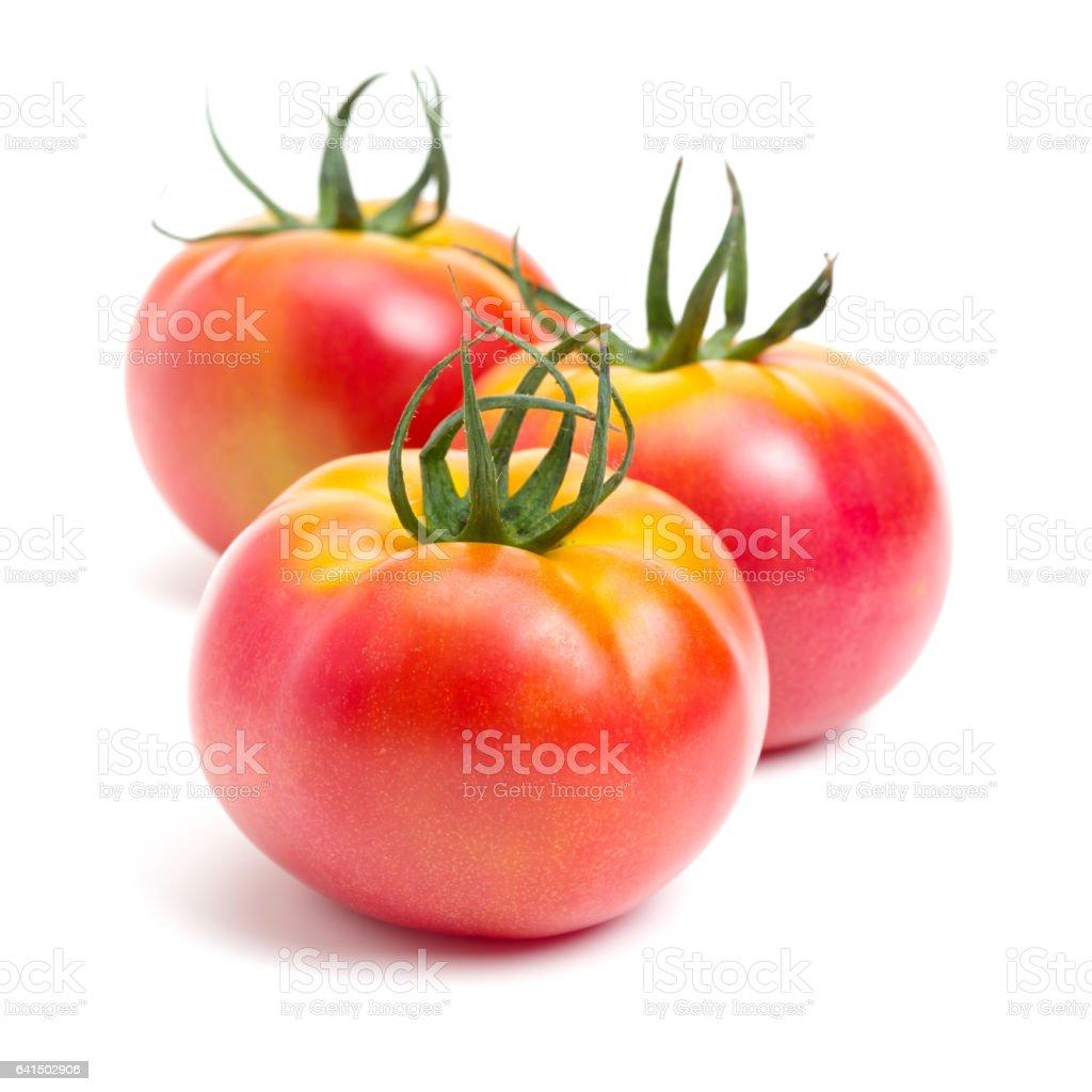 Fresh tomatoes isolated on white stock photo