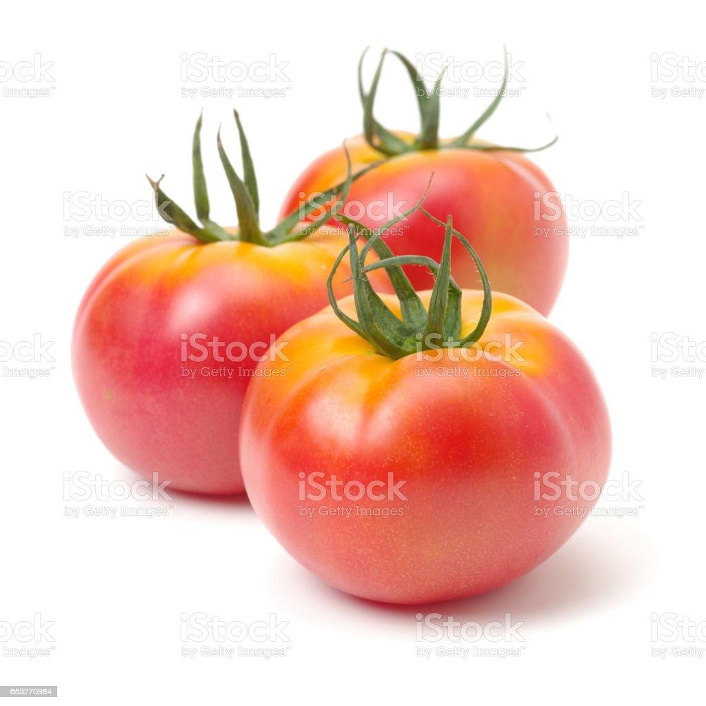 Fresh tomatoes  on a white background stock photo
