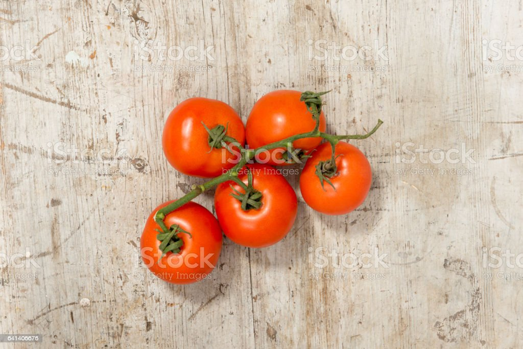 Fresh Tomatoes on a Wooden Background stock photo