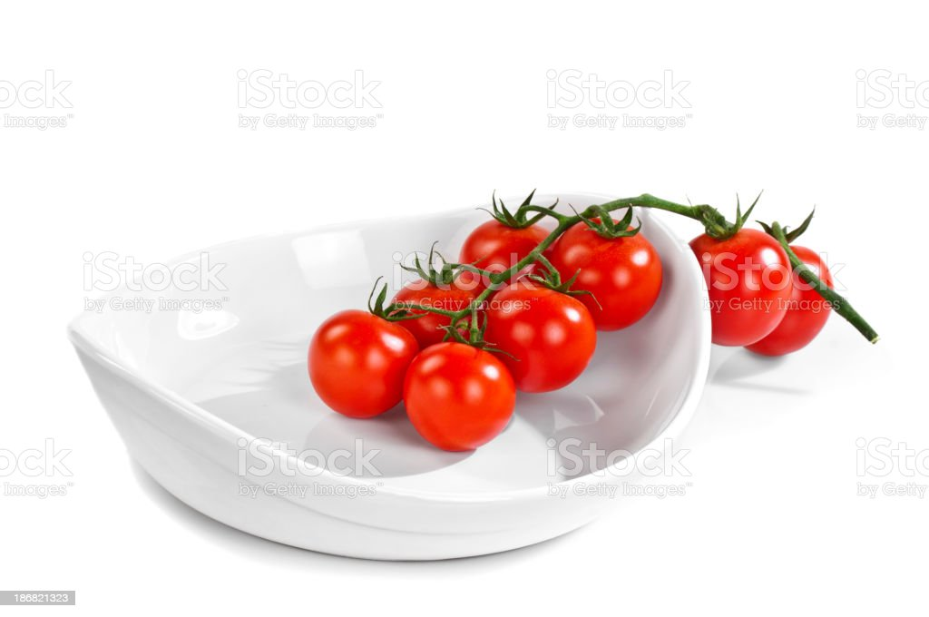 Fresh tomatoes on plate royalty-free stock photo