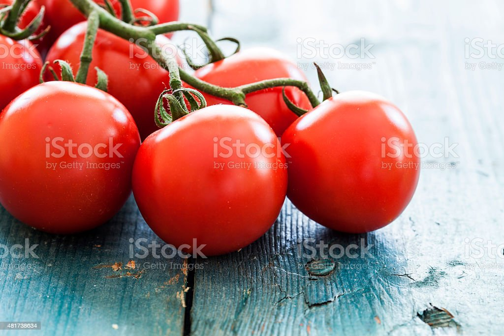 Fresh tomatoes on vintage table stock photo