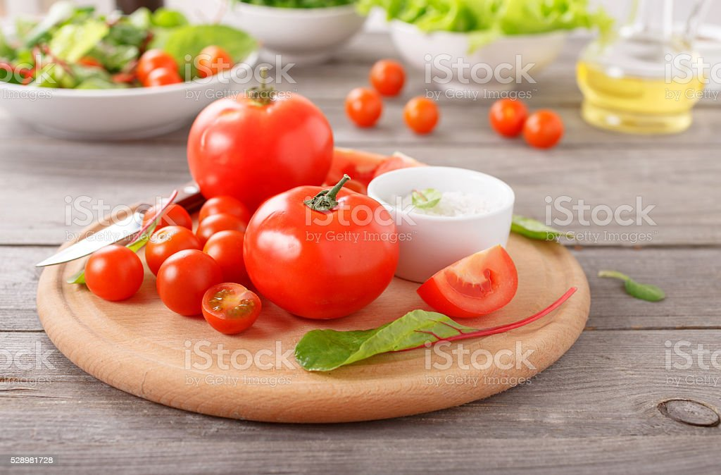 Fresh tomatoes on wooden table stock photo