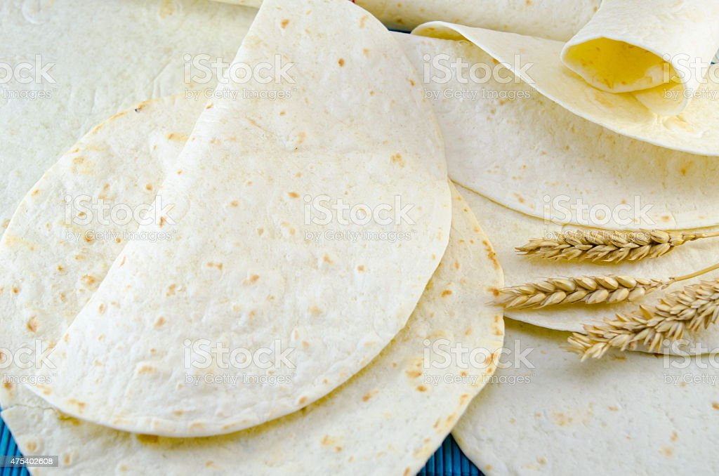 Fresh tortillas and a stick of wheat stock photo