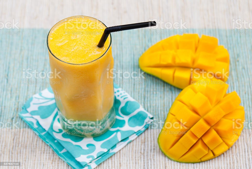 Fresh tropical fruit smoothie mango juice stock photo