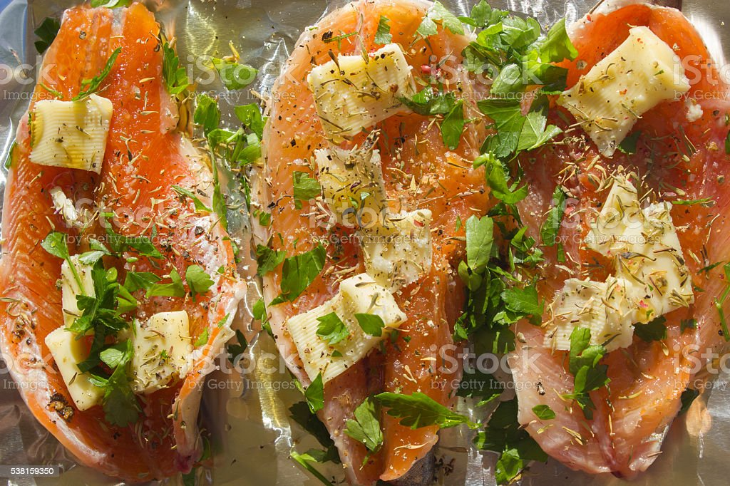 Fresh Trout in Foil Paper – Ready for Cooking stock photo