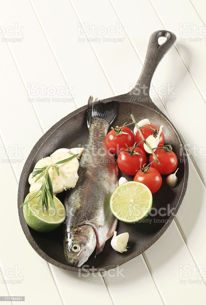 Fresh trout on a skillet royalty-free stock photo