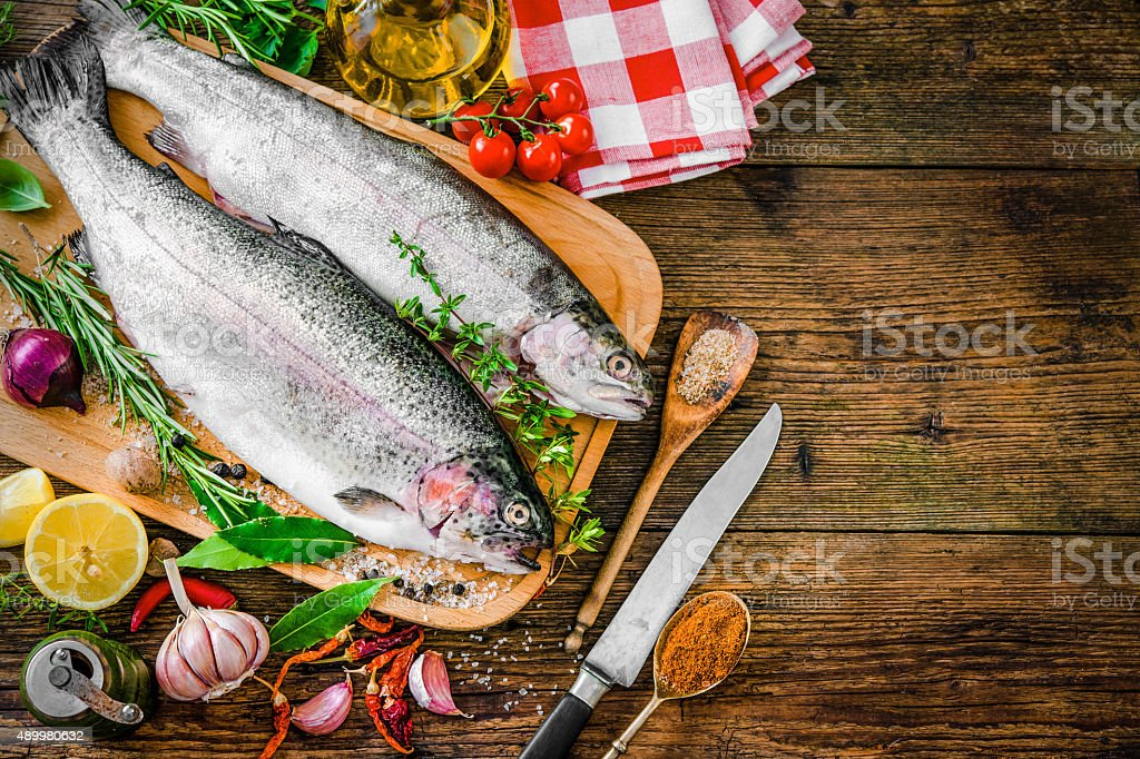 Fresh trout with spices and seasoning stock photo
