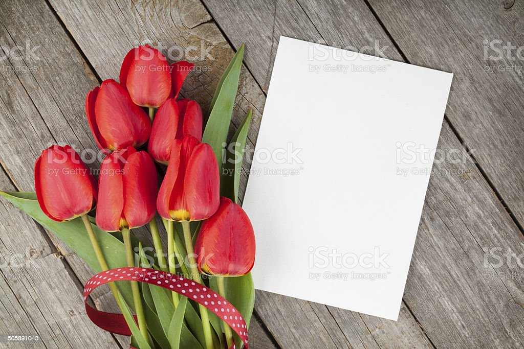 Fresh tulips bouquet and blank card for copy space stock photo