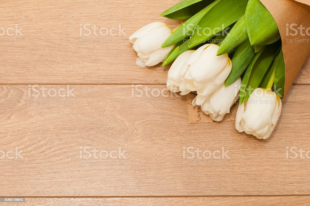 Fresh tulips flowers on wooden planks stock photo