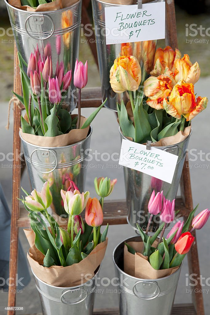 fresh tulips for sale at a farmer's market stock photo