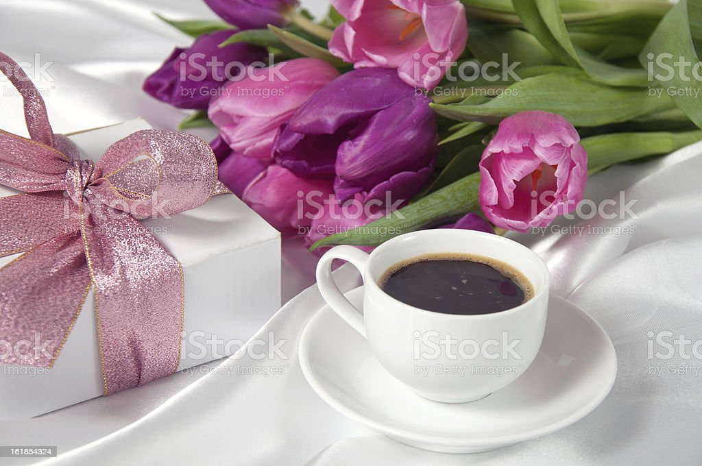 Fresh tulips with gift box and coffee breakfast royalty-free stock photo
