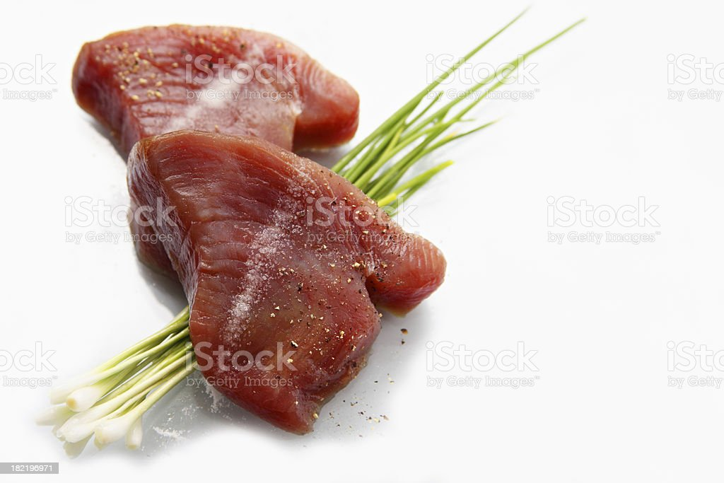 Fresh tuna steaks salted and peppered royalty-free stock photo