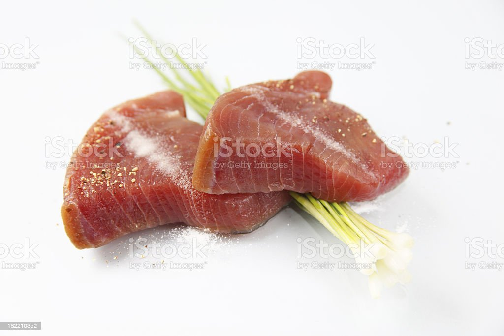 Fresh tuna steaks salted and peppered stock photo