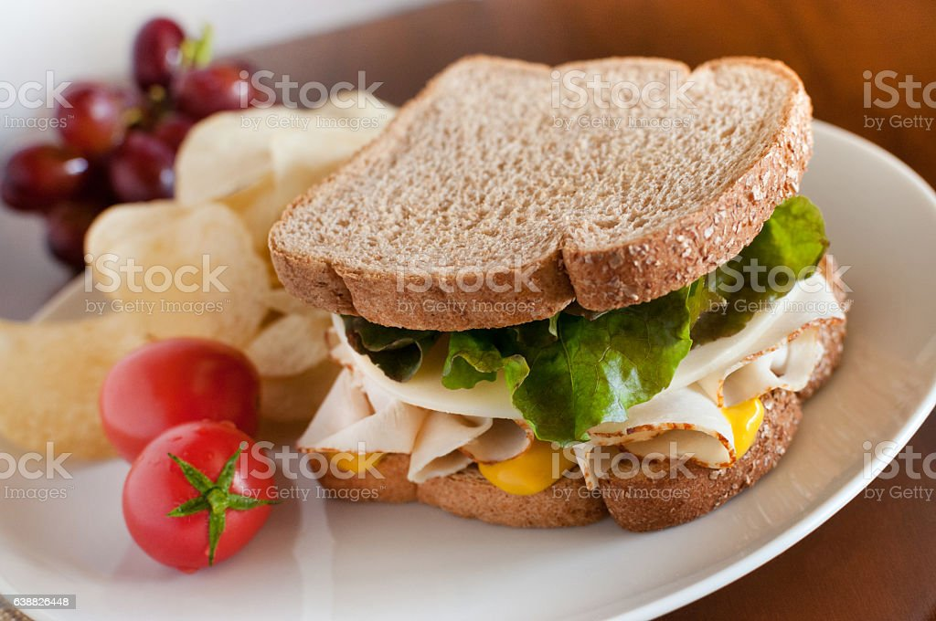 Fresh Turkey Sandwich on Wheat Bread with Potato Chips stock photo