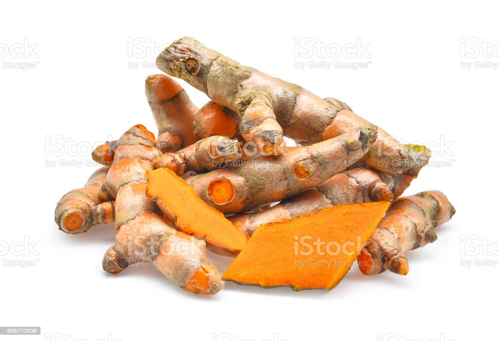 fresh turmeric roots isolated on white background stock photo