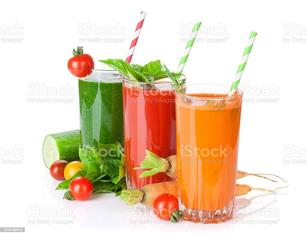 Fresh vegetable juices. Tomato, cucumber, carrot stock photo